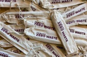 Burlap bags with Toward Zero Waste logo on them