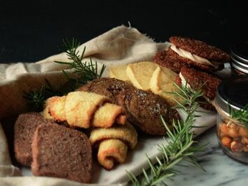 A festive tray of an assortment of holiday cookies and baked goods.