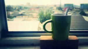 coffee cup in window