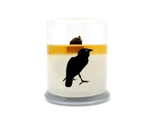 A pure soy wax candle from Sea Witch Botanicals with the silhouette of a raven on the side.