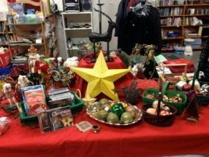 An assortment of holiday decorations and stocking stuffers displayed at Wise Buys.